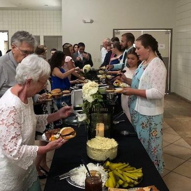 Parents and Grandparents enjoying a catered meal